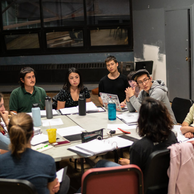 """The cast and production team of """"Amputees,"""" a play written by Quentin Nguyen-Duy, is part of BU School of Theatre's New Play Initiative and scheduled to debut on October 23, 2019. Cast member Sebastian Garbe (CFA'20) (from left), director Sarah Shin (CFA'19), Quentin Nguyen-Duy (CFA'20), dramaturg McKayla Witt (CFA'22), cast members  Will Edelson (CFA'22), Grace Ferrera (CFA'22), Rob Kellog (CFA'20), and Carey Lin (COM'20) sit for a table read on September 25, 2019. Photo by Sophie Park (CAS'20)"""